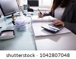 close up of a businesswoman's... | Shutterstock . vector #1042807048