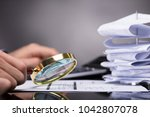 close up of a businessperson's... | Shutterstock . vector #1042807078