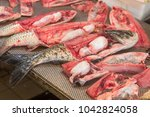 freshly cut fish at the market... | Shutterstock . vector #1042824058
