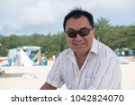 elderly man in sunglasses and a ... | Shutterstock . vector #1042824070