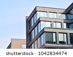 glass walls of a office... | Shutterstock . vector #1042834474