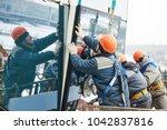 facade glass window installation | Shutterstock . vector #1042837816