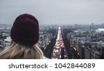 girl looks on champs elysees... | Shutterstock . vector #1042844089