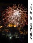 fireworks explode over the... | Shutterstock . vector #1042849819