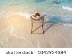 young lady relaxing in a chair... | Shutterstock . vector #1042924384