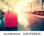 traveling luggage and trains in ... | Shutterstock . vector #1042928830