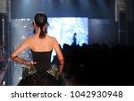 black dress model walk back on... | Shutterstock . vector #1042930948