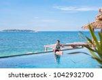 outdoor summer portrait of... | Shutterstock . vector #1042932700