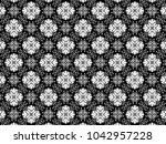 ornament with elements of black ...   Shutterstock . vector #1042957228