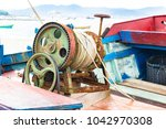 an old manual oxided winch... | Shutterstock . vector #1042970308