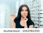 woman thinking to choose... | Shutterstock . vector #1042982350