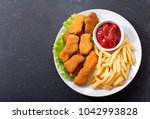 plate of chicken nuggets with... | Shutterstock . vector #1042993828