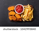 chicken nuggets with french... | Shutterstock . vector #1042993840