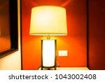 table lamp in the bedroom | Shutterstock . vector #1043002408