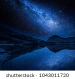 milky way and stars reflection... | Shutterstock . vector #1043011720