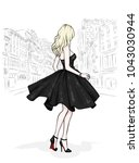a beautiful slender girl with... | Shutterstock .eps vector #1043030944