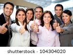 Business group with thumbs up at the office - stock photo