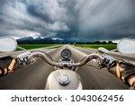 Biker On A Motorcycle Hurtling...