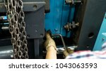 a worker is setting up a steel... | Shutterstock . vector #1043063593