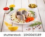 Stock photo marinated herring on wooden background 1043065189