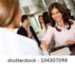 Successful businesswoman checking in a hotel and smiling - stock photo