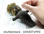 vintage voodoo doll on wooden... | Shutterstock . vector #1043071993