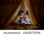 two girls read fairy tales at...
