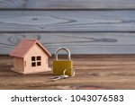 concept of a small house and a... | Shutterstock . vector #1043076583