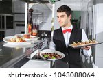 the waiter with the ready... | Shutterstock . vector #1043088064