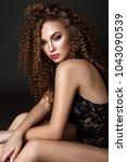 beauty woman portrait on black... | Shutterstock . vector #1043090539