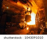 steel production in electric... | Shutterstock . vector #1043091010