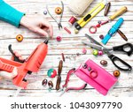 woman makes an ornament from... | Shutterstock . vector #1043097790