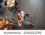 young loving couple sitting on...   Shutterstock . vector #1043102290