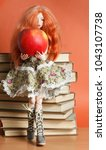 beautiful doll with an apple... | Shutterstock . vector #1043107738