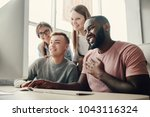 young people smiling  sitting... | Shutterstock . vector #1043116324