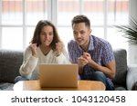 nervous excited couple in... | Shutterstock . vector #1043120458