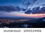 sunset over a city. the sky is... | Shutterstock . vector #1043124406