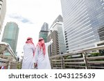 arab salesman is pointing his... | Shutterstock . vector #1043125639