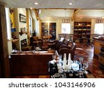 wine display area at gibbston... | Shutterstock . vector #1043146906