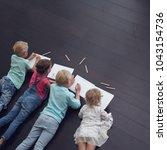 group of cute children drawing... | Shutterstock . vector #1043154736