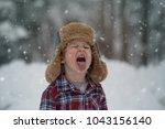 a little boy is outside...   Shutterstock . vector #1043156140