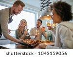 friends having fun dining... | Shutterstock . vector #1043159056