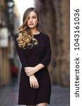 blonde woman in urban... | Shutterstock . vector #1043161036