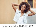 young black woman  afro... | Shutterstock . vector #1043161423