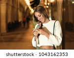 blonde woman looking at her... | Shutterstock . vector #1043162353