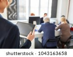 woman holds tablet computer at...   Shutterstock . vector #1043163658