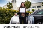 young surprised woman holds... | Shutterstock . vector #1043163748