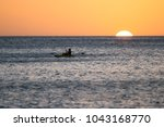 young man kayaking in the ocean ... | Shutterstock . vector #1043168770