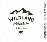 vintage wilderness logo. hand... | Shutterstock .eps vector #1043175550