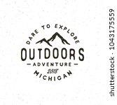 vintage wilderness logo. hand... | Shutterstock .eps vector #1043175559